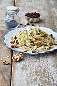 Silesian poppy seed pasta with nuts and raisins