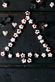 Star-shaped marshmallows and sugar hearts arranged in a Christmas tree shape