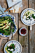 Spinach salad with peas, pears, pomegranate seeds and goat's cheese