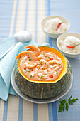 Prawns in a creamy coconut sauce served in a pumpkin