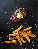Beef fillet steak with herb butter and chips