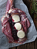Raw stuffed leg of lamb with mozzarella and apple and blackberry jam