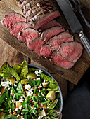 Roast beef with a pea pod salad