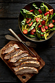 Secreto pork fillet with a strawberry salad