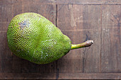 A jackfruit on a wooden surface