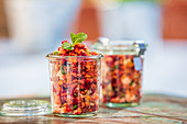 Red lentil salad in glass jars