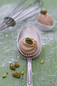 A chestnut praline with a pistachio