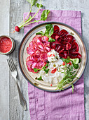 Vegetable carpaccio with beetroot, chiogga beets and radishes, cashew cream and a strawberry dressing