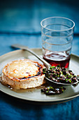 Oven-baked goat's cheese with honey and tapenade