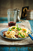 Lemon noodles with pancetta, garlic and olives