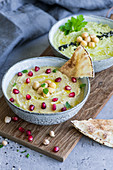 Traditional hummus and avocado hummus in bowls (Arabia)