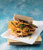Carrot noodle sandwich with pepper hummus