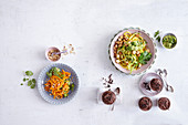 Vegetarian low carb menu with carrot salad, kohlrabi noodles and chocolate mousse