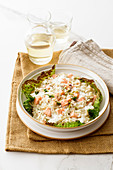 Creamy risotto with salmon and robiola on a Savoy cabbage leaf