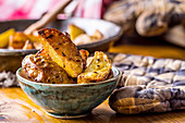 Roasted potato wedges in a small bowl