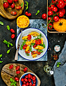 A salad of yellow and red tomatoes with basil