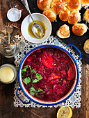 Beetroot soup with parsley, tomato and lemon