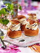 Semla (yeast pastries with whipped cream and cocoa powder, Sweden)