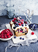 Berry cake with quark cream served with fresh berries