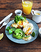 Toast with poached egg, sauce Hollandaise and avocado