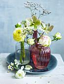 Various flowers in vases (ranunculus, hellebore)