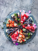 Watermelon pizza with berries and agave syrup