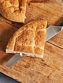Unleavened bread being sliced