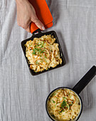 Gratinated cheese pasta from the oven and in a raclette pan