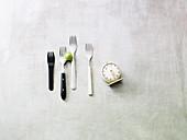 An arrangement of forks and a kitchen timer