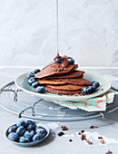 Sugar-free vegan chocolate pancakes with blueberries
