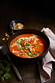 Coconut and tomato soup with peanuts
