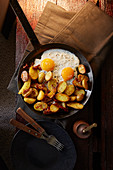 Thyme roast potatoes with dried tomatoes and fried egg