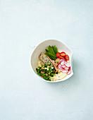 Polenta bowl with salmon and mangetout