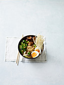 Ramen bowl with pak choi, mushrooms and egg