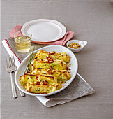 Herb cannelloni with Robiola cheese cream, bacon and pine nuts
