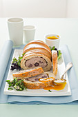 Meatloaf wrapped in bread with a honey-mustard sauce