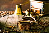 An arrangement of Turkish coffee in brass cups