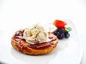 An apple tart with vanilla ice cream
