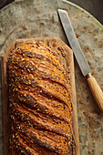 Seeded bread on a wooden chopping board