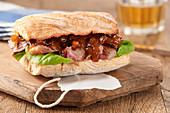 A pork sandwich with caramelised onion chutney