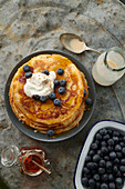 Pancakes with blueberries, maple syrup and cream