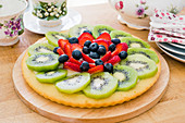 Fruit cake with kiwis, strawberries and blueberries