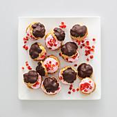 Strawberry profiteroles with dark chocolate glaze