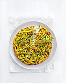 Spaghetti frittata with courgette and diced bacon