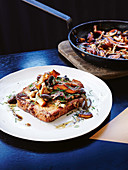 French toast with mixed mushrooms in a frying pan