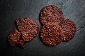 Chocolate biscuits on a dark stone surface