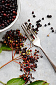 Elderberries with a fork