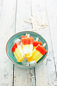Tri-colored melon ice creams on sticks (vegan)