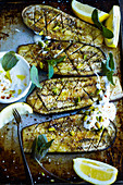 Grilled aubergines with yoghurt, mint and pistachios