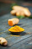 Raw organic orange turmeric root and powder